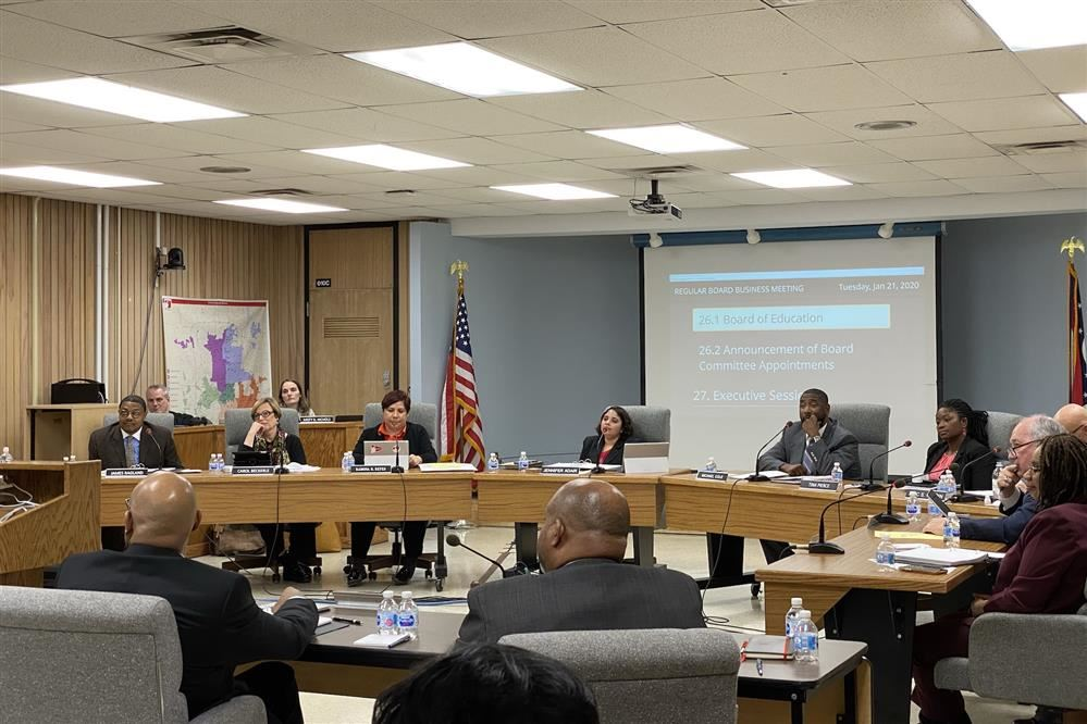 Board Seated At Meeting