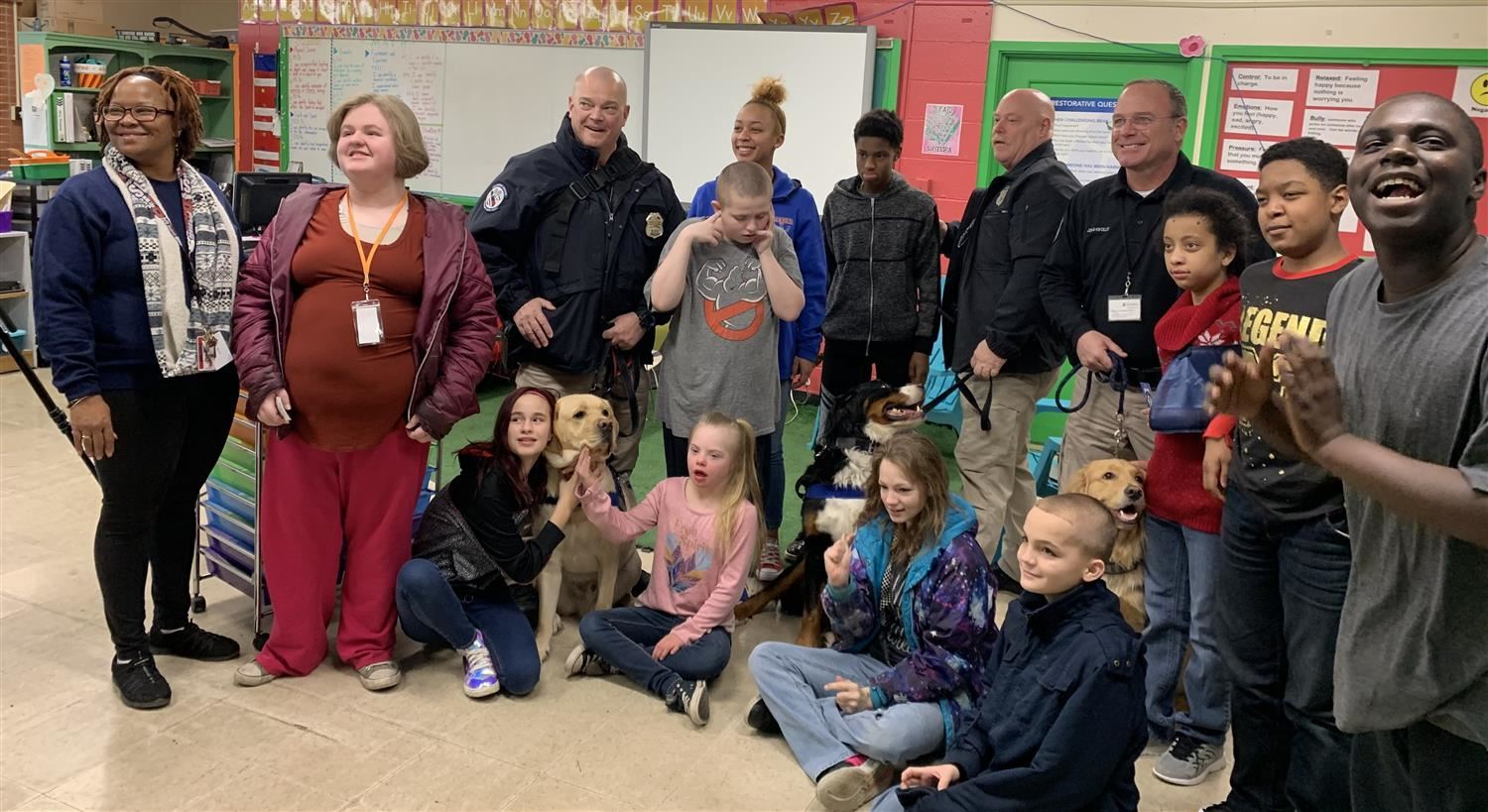 Students with therapy dogs