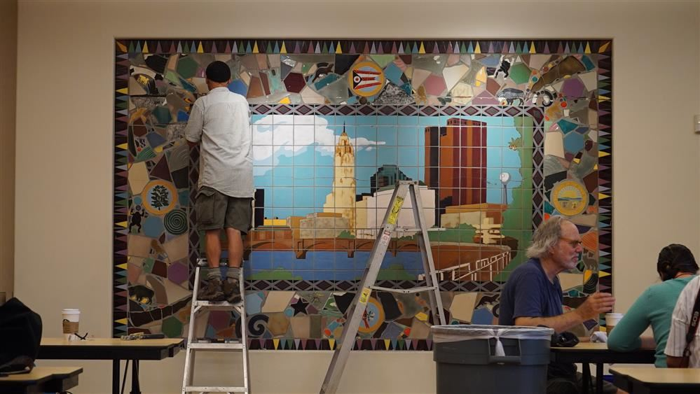 Jim Marshalls makes repairs to historic Skyline Mural