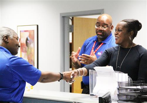 Dr. Dixon greets Safety and Security staff